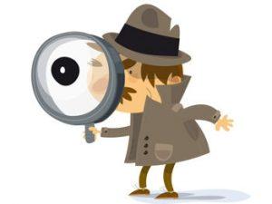 detective privé qui cherche avec une loupe